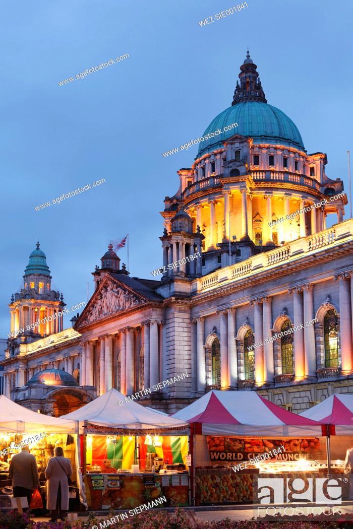 Stock Photo: United Kingdom, Ireland, Ireland, Northern Ireland, Belfast, View of city hall at dusk with market stalls in foreground.