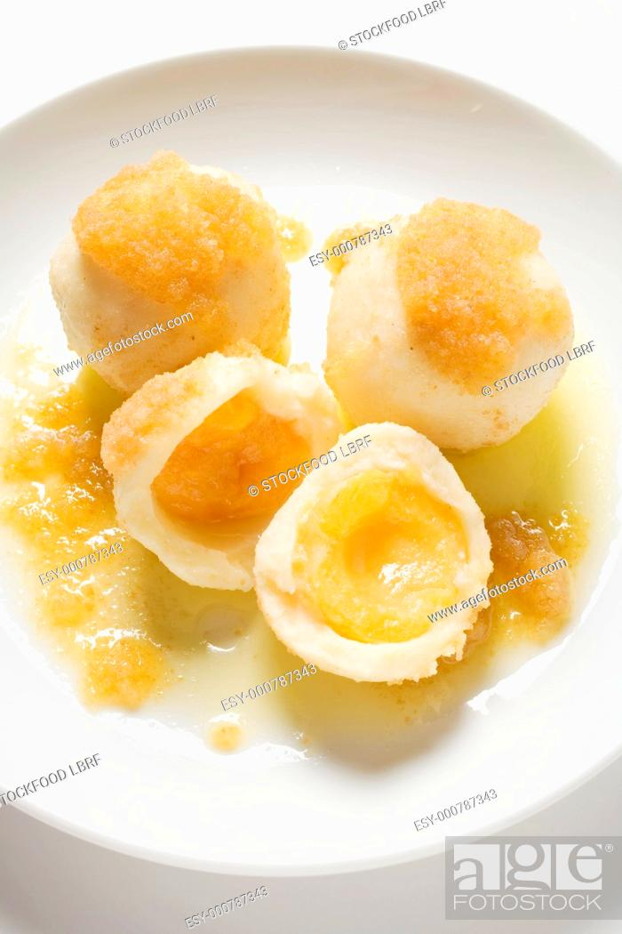 Stock Photo: Apricot dumplings with buttered breadcrumbs.