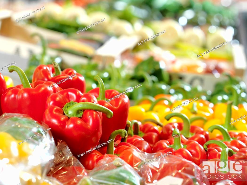 Stock Photo: Fresh bell peppers on display at supermarket.