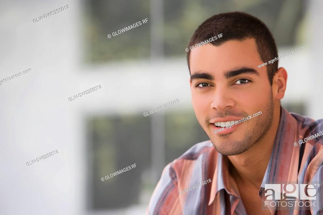 Stock Photo: Portrait of a young man smiling.
