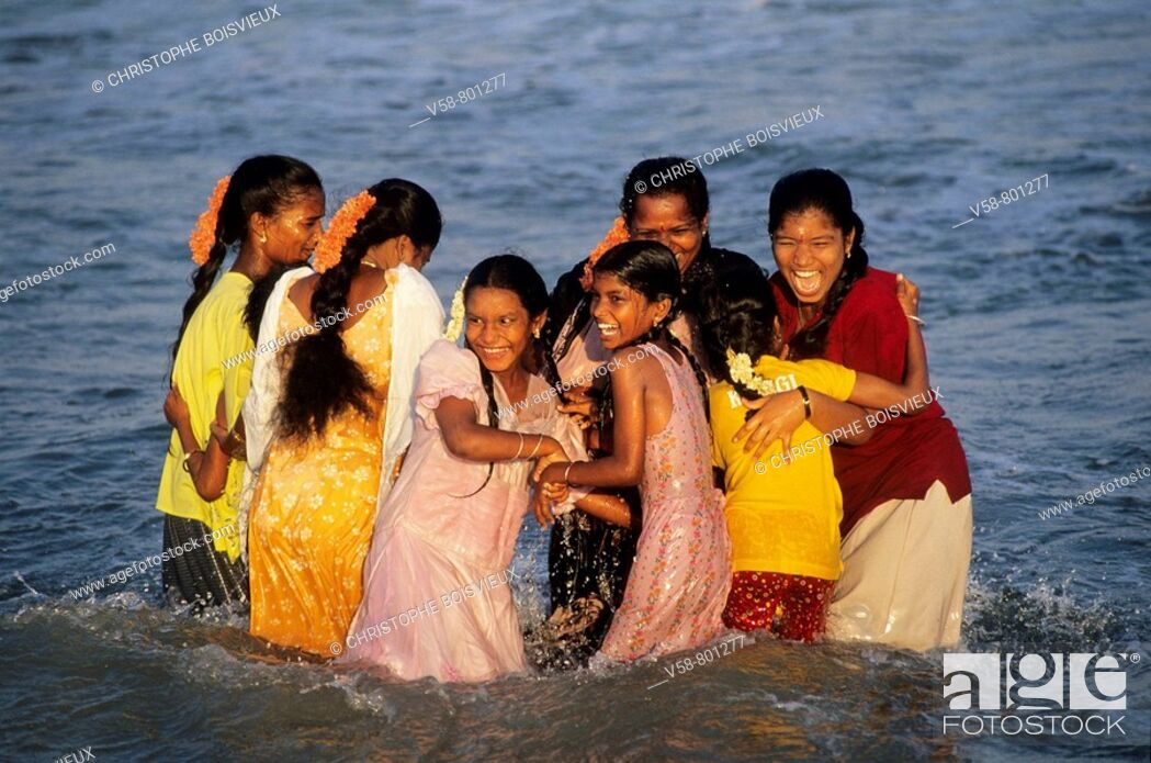Stock Photo: CHEERFUL GIRLS BATHING, MARINA BEACH, CHENNAI MADRAS, TAMIL NADU, INDIA.