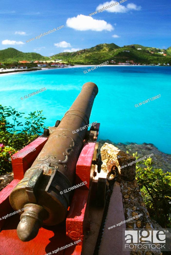 Stock Photo: An ornamental cannon near a seashore, St. Bant's.