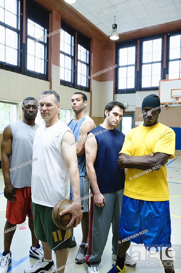 Stock Photo: Portrait of male basketball team.