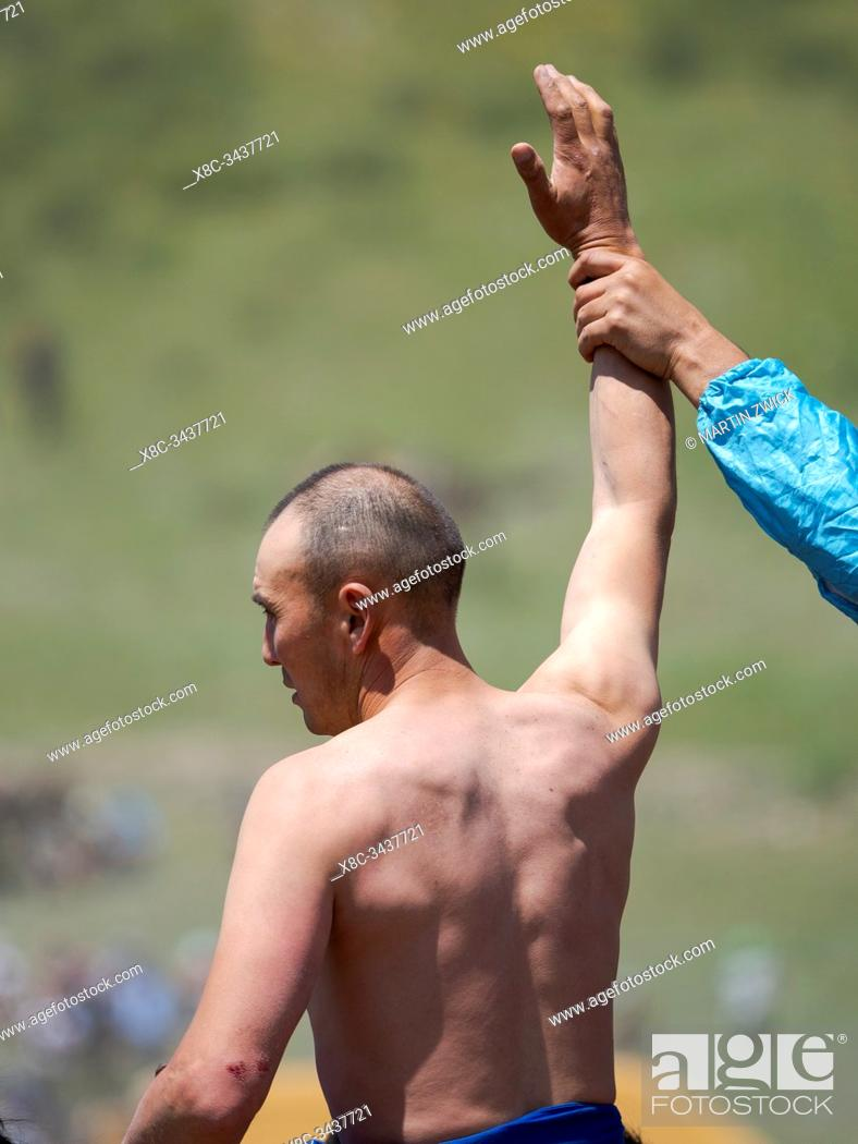 Stock Photo: Portrait of a competitor. Er Enish or Oodarysh, wrestling from horseback, a traditional equestrian sport. Folk and Sport festival on the Suusamyr plain.