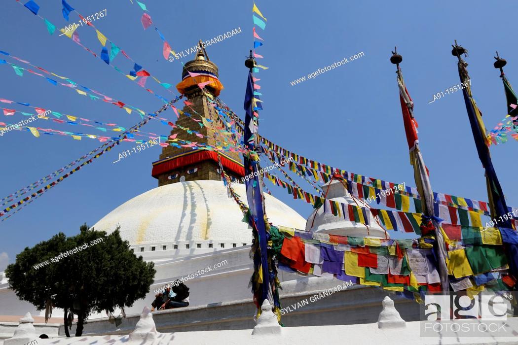 Stock Photo: Nepal, City of Katmandu, buddhist Boudnath tibetan temple, the big stuipa and prayers flags.