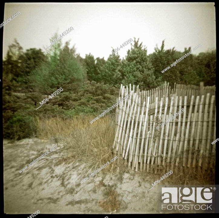 Stock Photo: an atmospheric image of the sand and landscape around Barnegat Lighthouse in Barnegat, New Jersey.