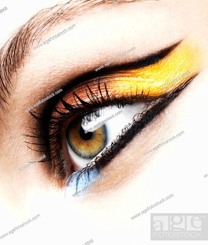 Stock Photo: Woman Wearing Colorful Eye Makeup, Close Up.
