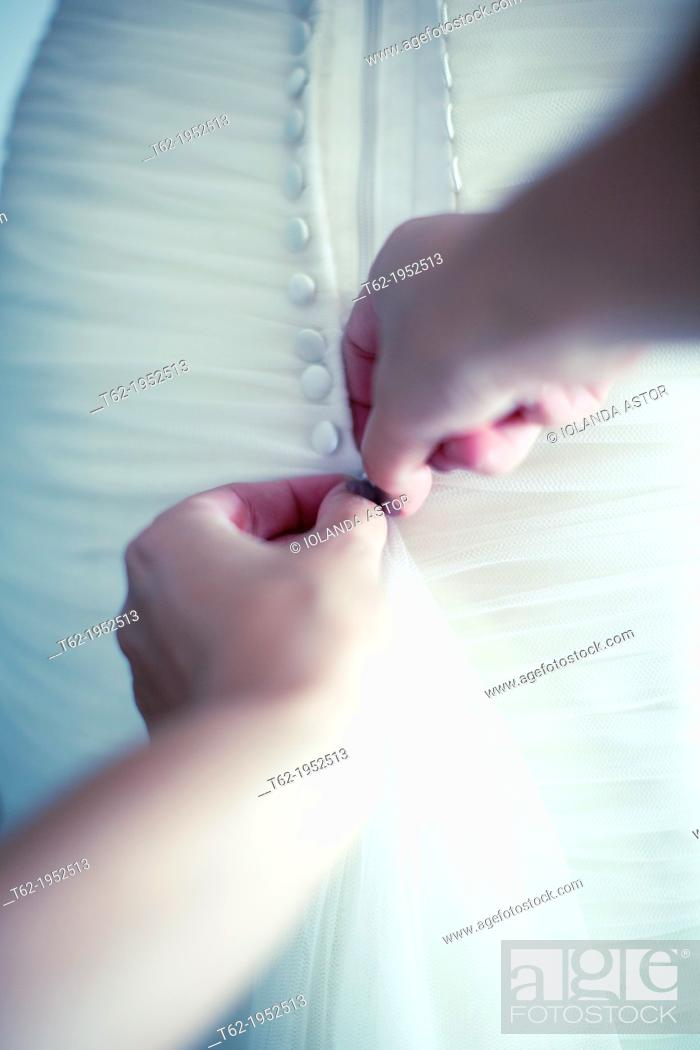Stock Photo: Helping the bride dress for the wedding. Color.