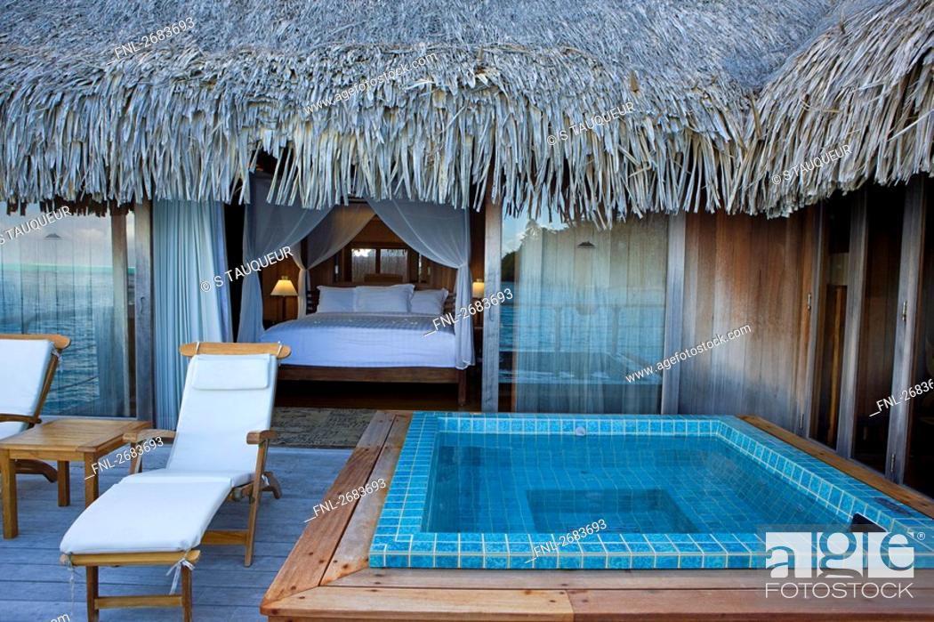 Bathtub And Lounge Chairs In Front Of Hotel Bedroom Bora