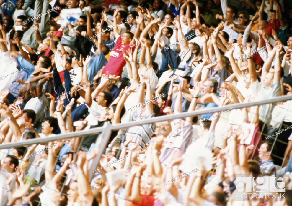Stock Photo: Crowd in stadium with arms in air.