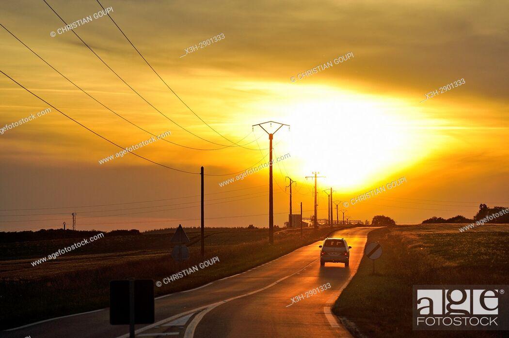 Stock Photo: country road at sunset, Eure-et-Loir department, Centre-Val de Loire region, France, Europe.