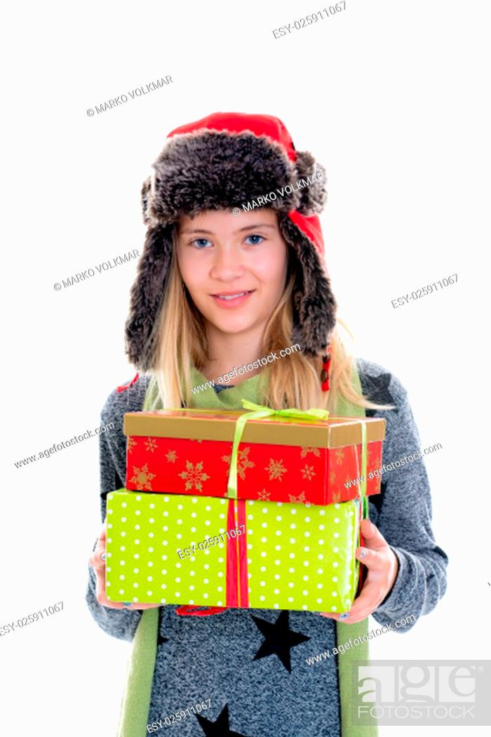 Stock Photo: nice blond girl with gift boxes, cap and scarf in front of white background.