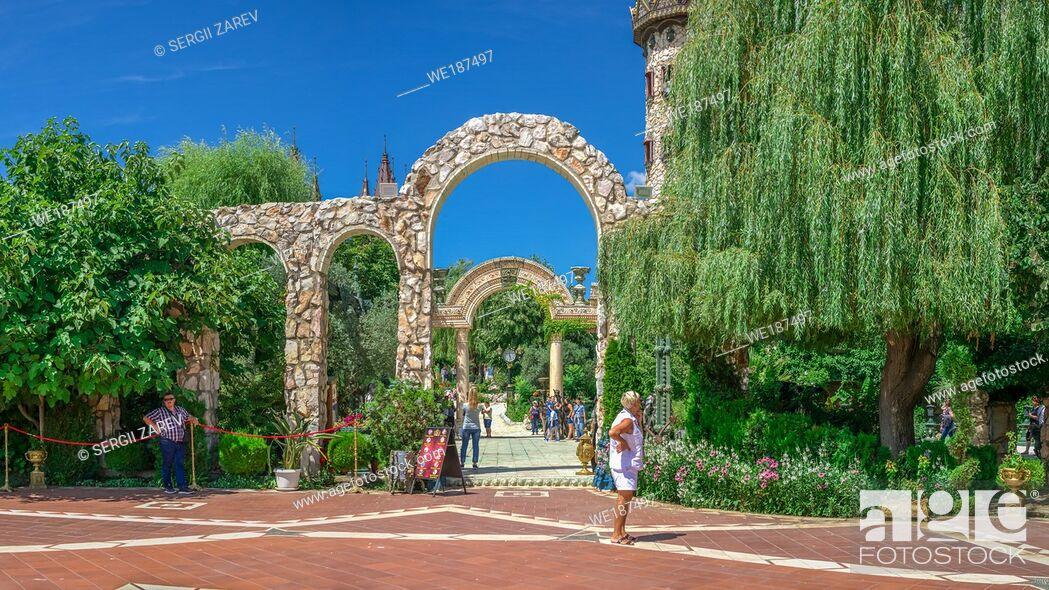 "Stock Photo: Ravadinovo, Bulgaria â. "" 07. 11. 2019. Arched gate in the park of Ravadinovo castle, Bulgaria, on a summer sunny day."