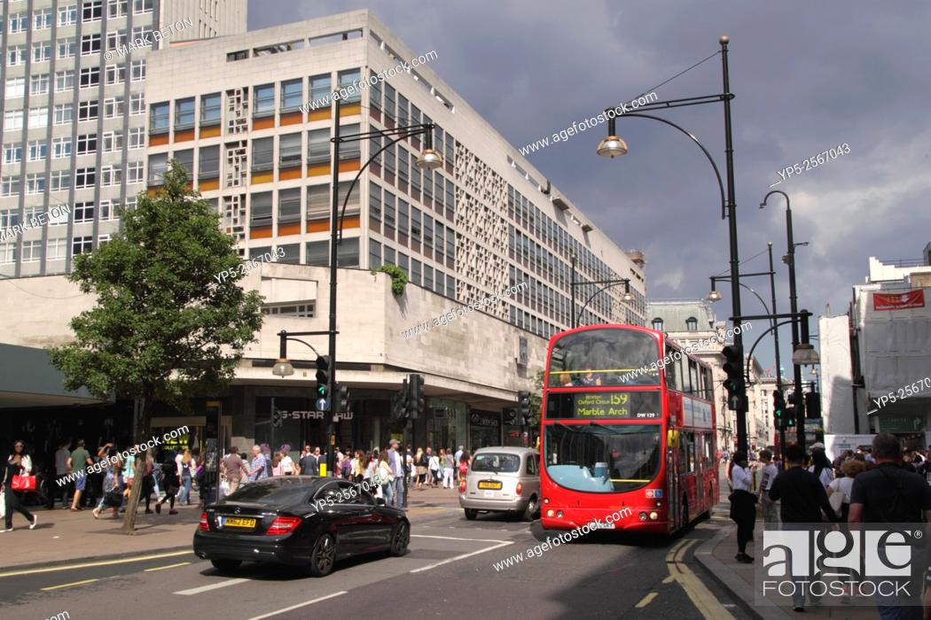 Stock Photo: Oxford Street London College of Fashion on left.