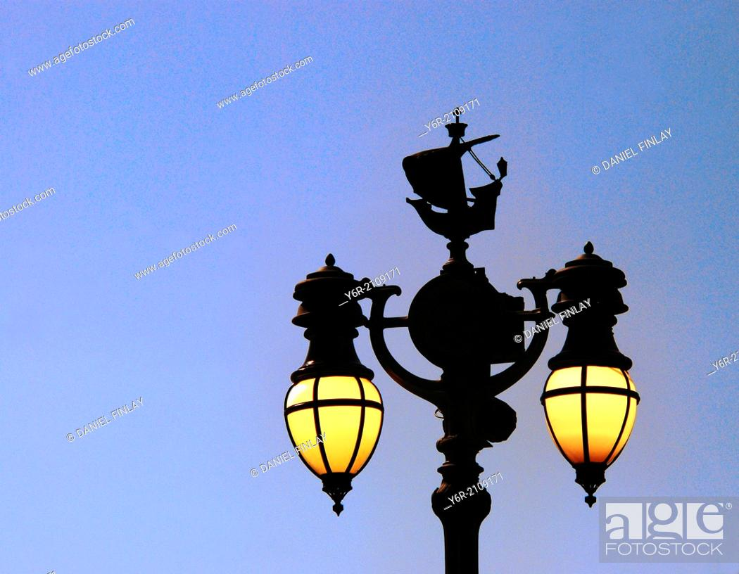 Stock Photo: Elaborate street-lamp in the royal quarter in the heart of London, England, at dusk.