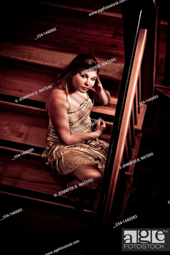 Stock Photo: A teen girl sitting on a stairway.