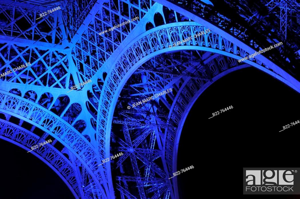 Stock Photo: June 30, 2008. France marks the start of its six-month presidency of the European Union by lighting up the Eiffel Tower in blue with yellow stars.