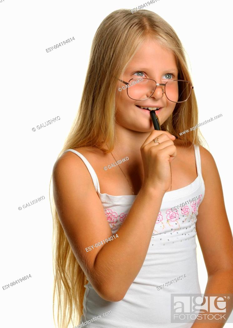 Stock Photo: The thoughtful girl the blonde in glasses and with pen.