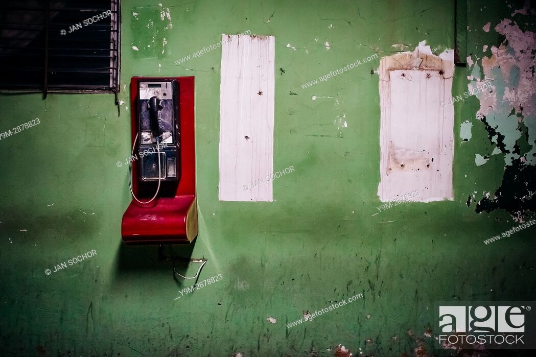Stock Photo: A public pay phone is seen hung on the wall in a patio inside the emergency department of a public hospital in San Salvador, El Salvador, 16 December 2015.