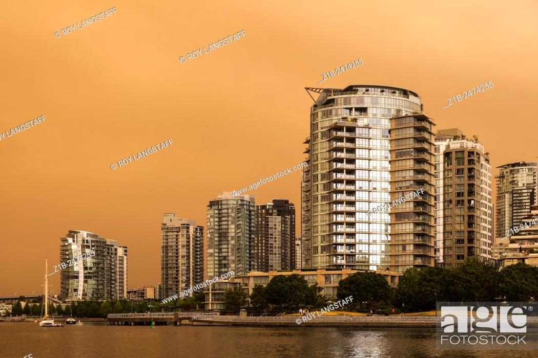 Stock Photo: Vancouver under a blanket of smoke from numerous forest fires burning in the region.