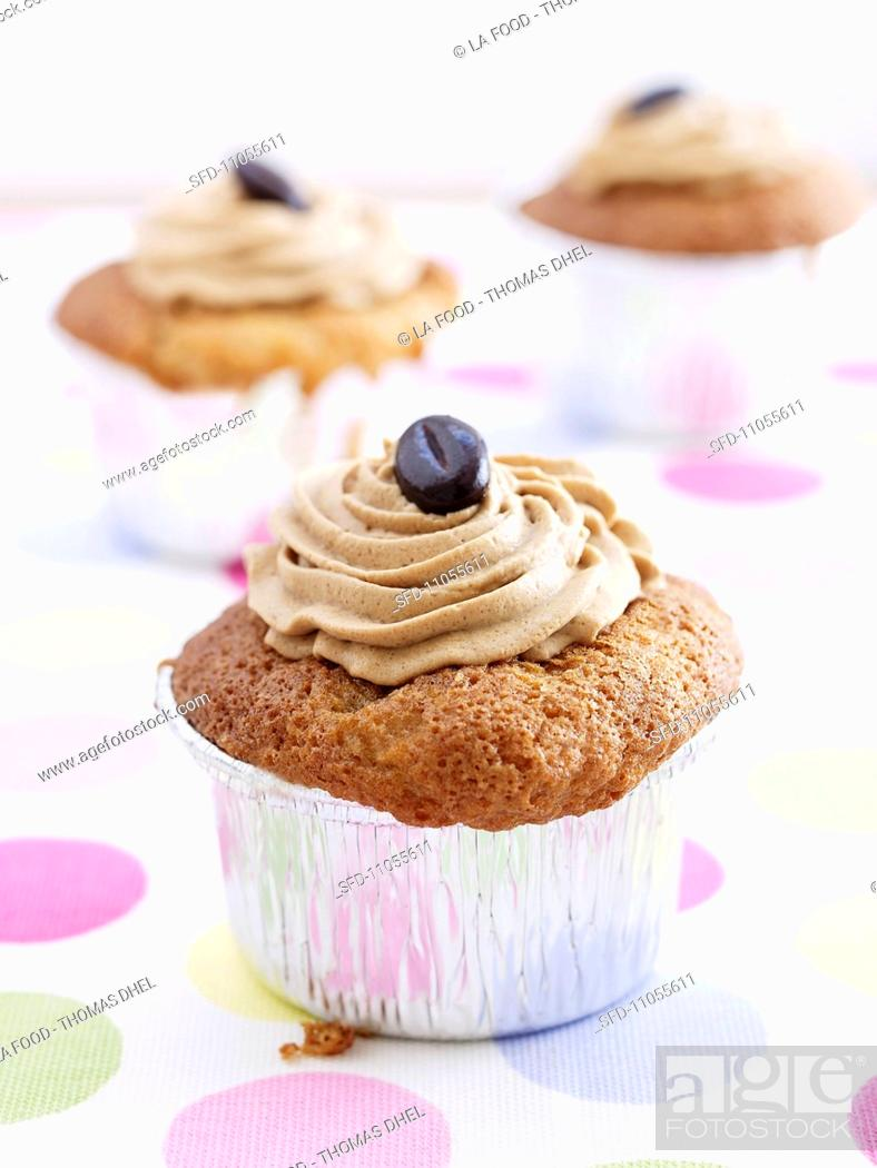 Stock Photo: Coffee-nut cupcake with mocha beans.