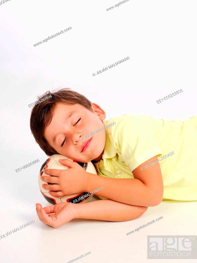 Stock Photo: Sleeping child posing on a ball head.