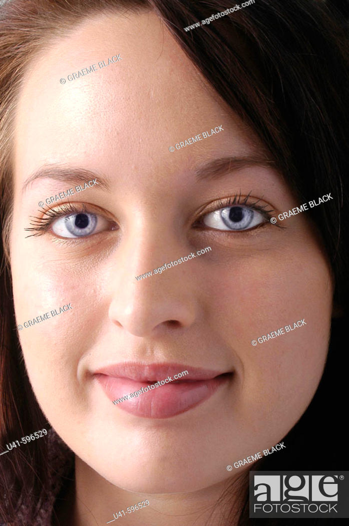Stock Photo: Full face shot of 22 year old  office worker.