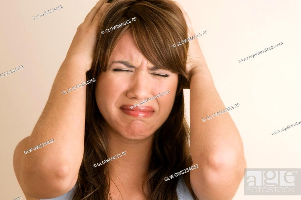 Stock Photo: Close-up of a young woman crying.