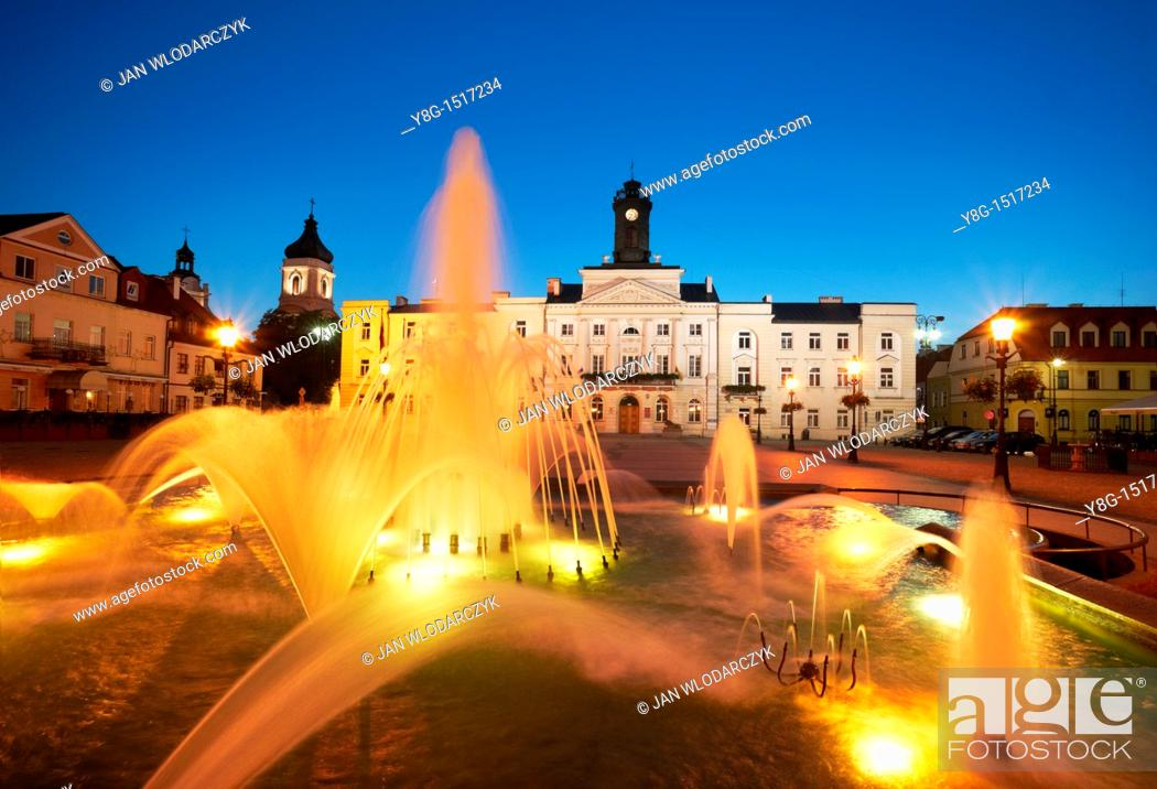 Stock Photo: Plock - Fountain and Town Hall at the Market Square, Poland, Europe.