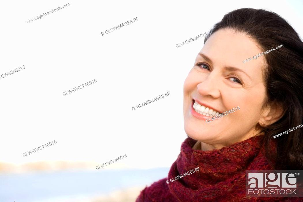 Stock Photo: Close-up of a mature woman smiling.