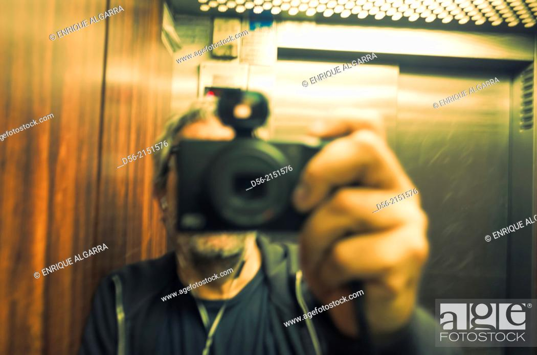 Stock Photo: self portrait in a lift.