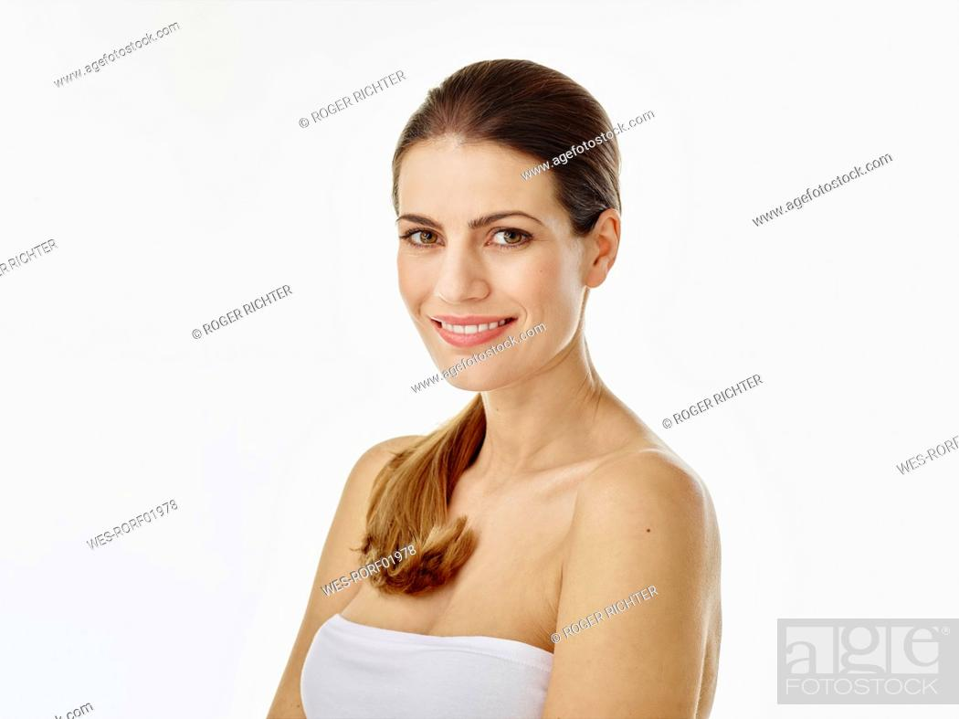 Stock Photo: Portrait of smiling woman against white background.