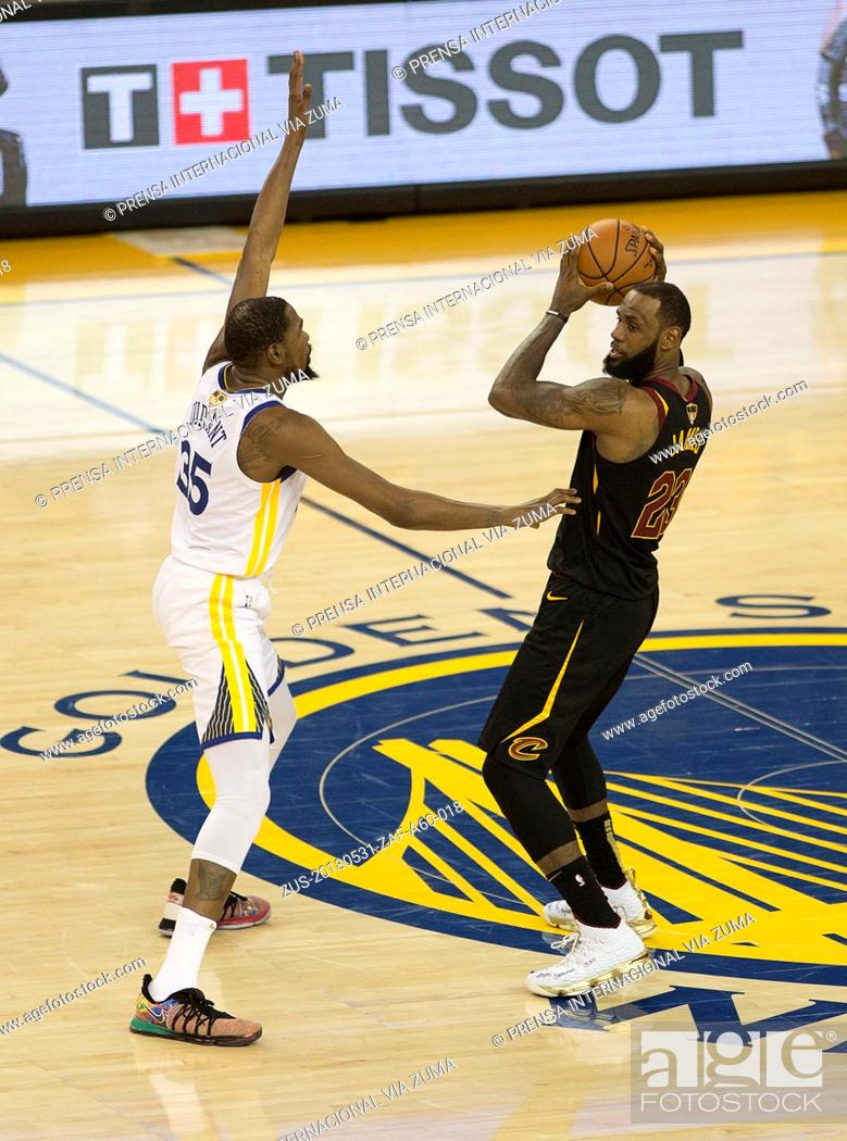 Stock Photo: May 31, 2018 - Oakland, CALIFORNIA, UNITED STATES OF AMERICA - LeBron James #23 of the Cleveland Cavaliers drives against Kevin Durant #35 of the Golden State.