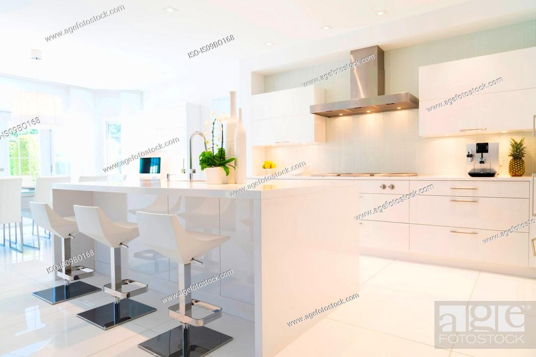 Image of: Modern Kitchen With White Italian Lacquered Kitchen Island And Chrome Barstools Inside Luxury Stock Photo Picture And Royalty Free Image Pic Iso Is09bo168 Agefotostock