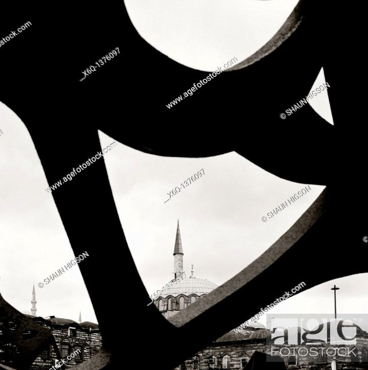 Stock Photo: Islamic minaret contrasts with modern art in Istanbul in Turkey in Middle East.