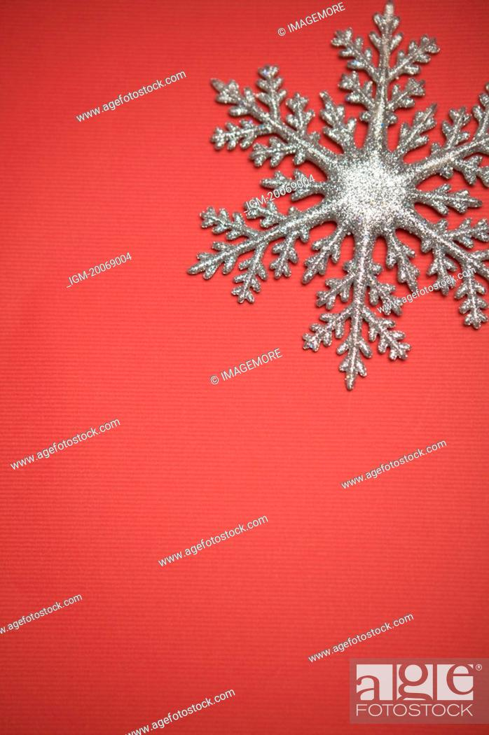 Stock Photo: Snowflake in red background.