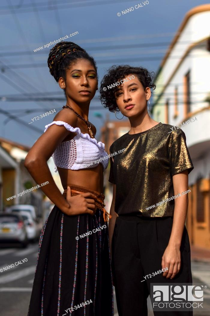 Stock Photo: Two latin young women in the streets of Cali, Colombia.