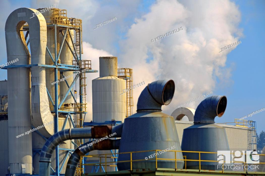 Stock Photo: Steam and other emissions coming from pulp mill, Quesnel, British Columbia.