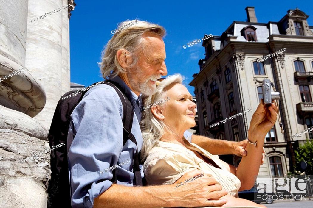 Stock Photo: Couple looking at camera.