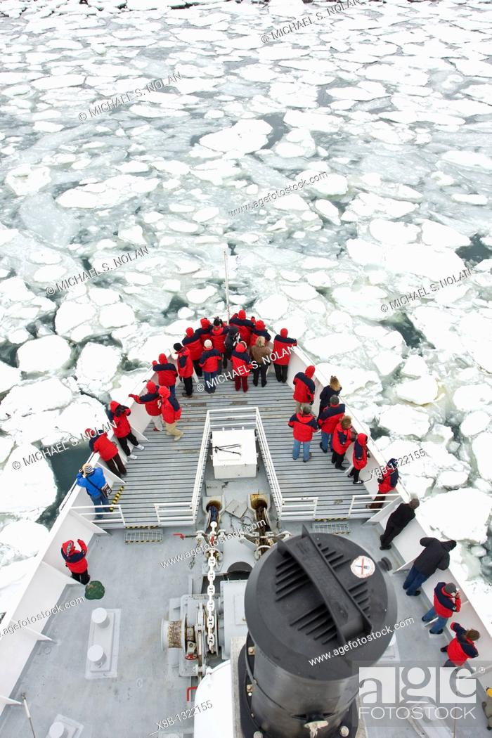 Stock Photo: The Lindblad expedition ship National Geographic Endeavour operating with it's fleet of Zodiacs in and around the Antarctic peninsula, Antarctica.