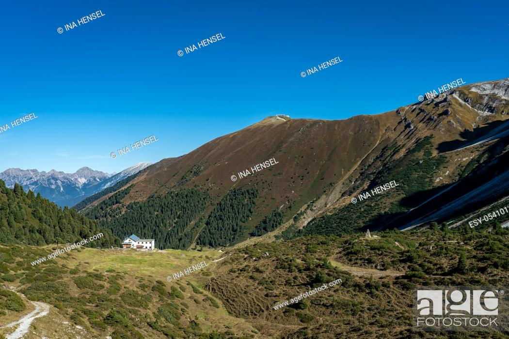 Stock Photo: View at the Senders valley and Adolf Pichler mountain hut near Kemater Alm in Austria with high rising mountains (Kalkkoegel) in the background.