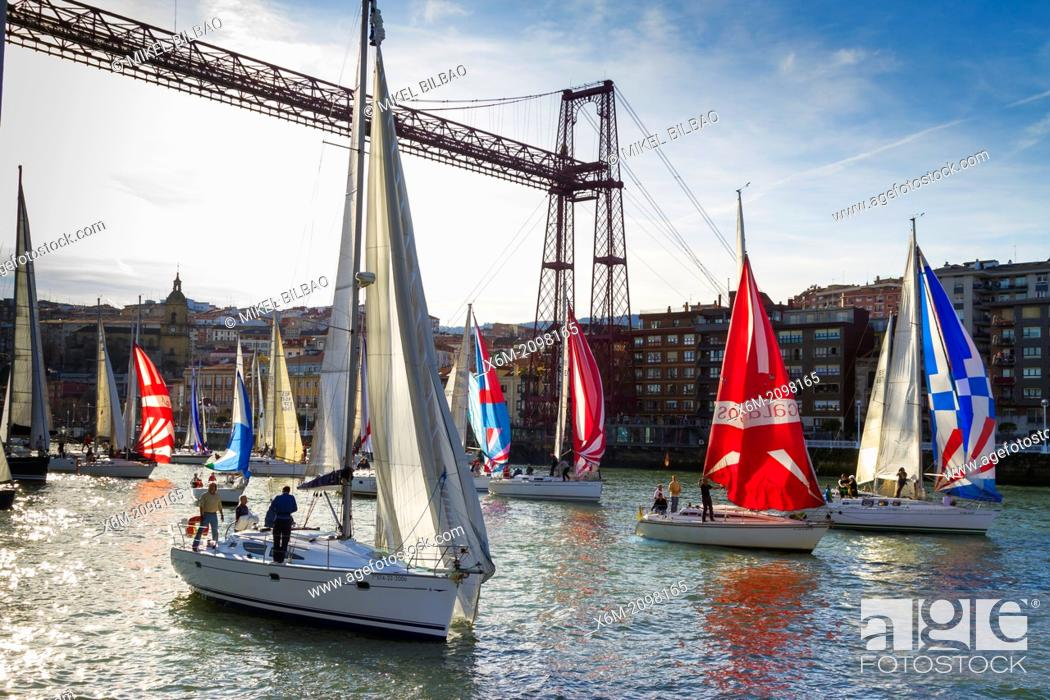 Stock Photo: Gallo boat race and Vizcaya bridge. Mouth of Nervion river. Portugalete, Biscay, Basque Country, Spain.