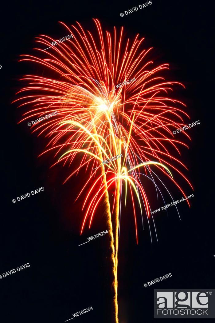 Stock Photo: Fireworks light up the night time sky.