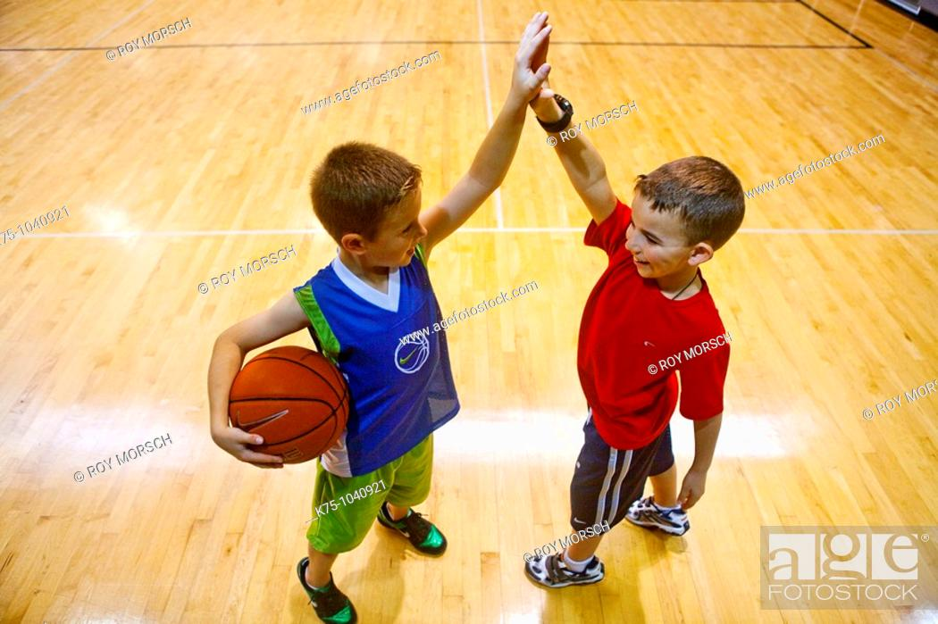 Stock Photo: high five after basketball.