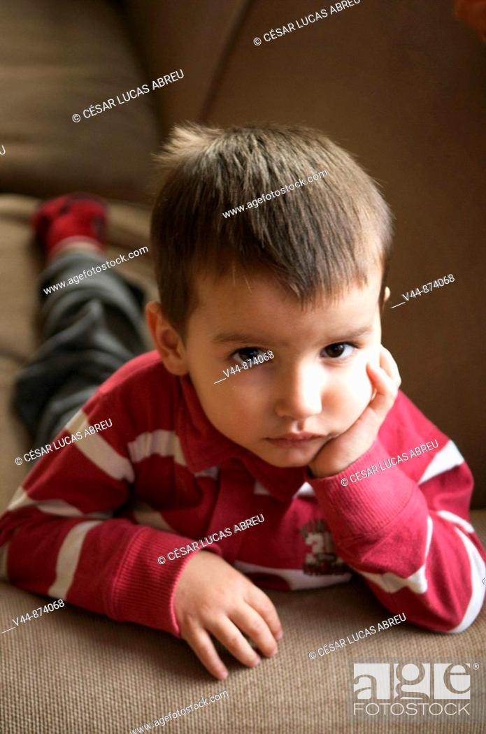 Stock Photo: 3 year old boy watching TV.