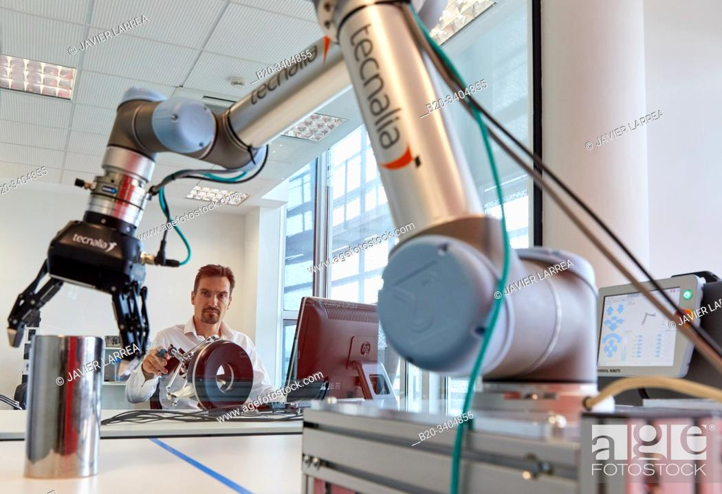 Stock Photo: Robot composed of two pieces, a robotic arm, motorized by a clamp to handle dangerous objects, the second part, is remote and is located in a safe area of the.