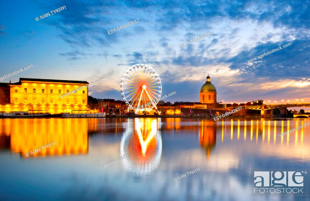 Stock Photo: View of Hospital de La Grave and Ferries Wheel reflected in Garone river. Toulouse, France.