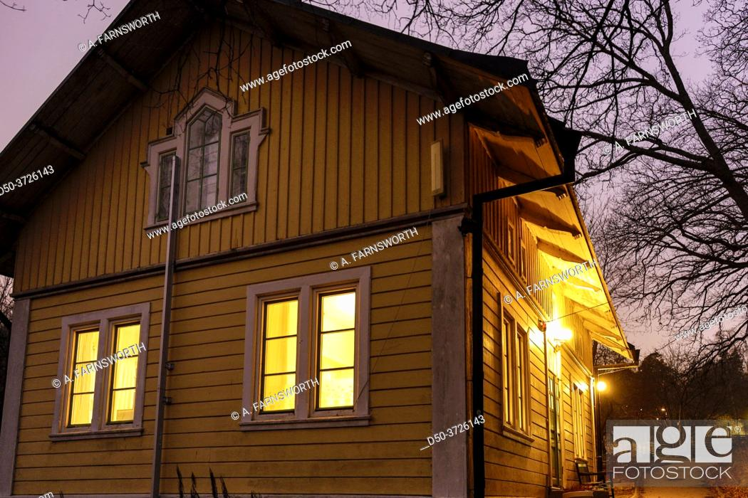 Stock Photo: Stockholm, Sweden A traditonal wooden house and lights in the Axelsberg suburb.