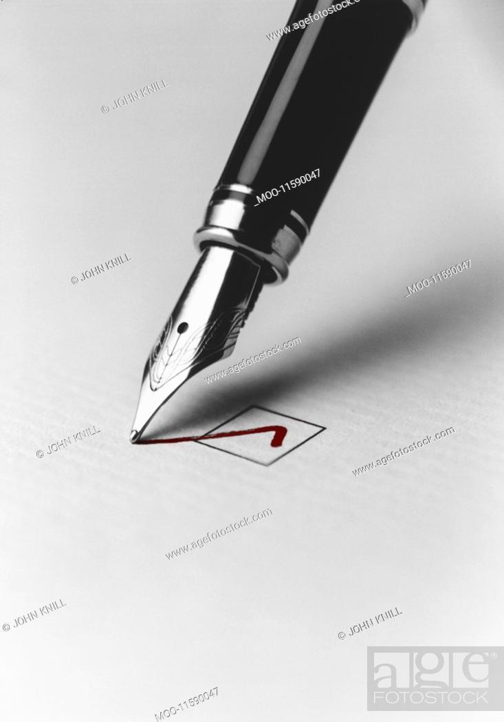Stock Photo: Pen Checking Box.