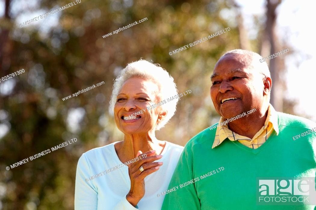 Stock Photo: Senior Couple Enjoying Walk Together.